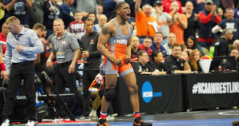 Lewis stuns Marinelli; PSU, Ohio State, Oklahoma State go undefeated in quarters