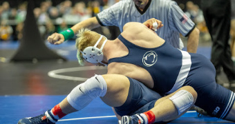 PSU leads team race after Day 1, Iowa sends 7 to quarterfinals