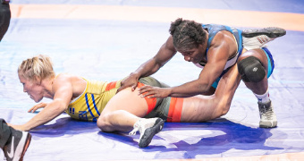 Mensah-Stock claims world title, Cox reaches finals